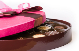 Gourmet chocolates tied with a pink ribbon